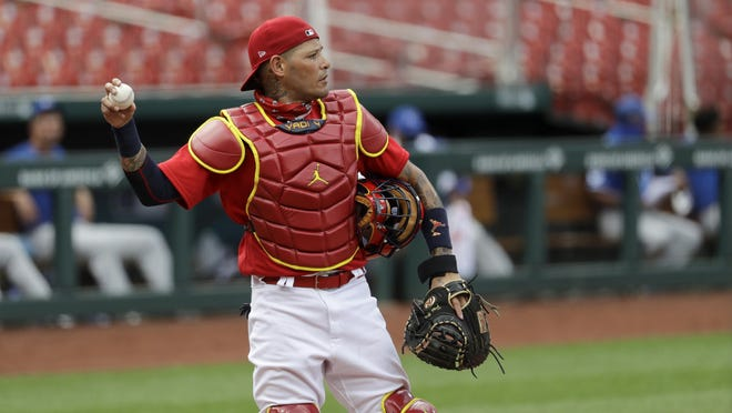 Catcher Yadier Molina is one of seven St. Louis Cardinals playiers who have test positive for the coronavirus.