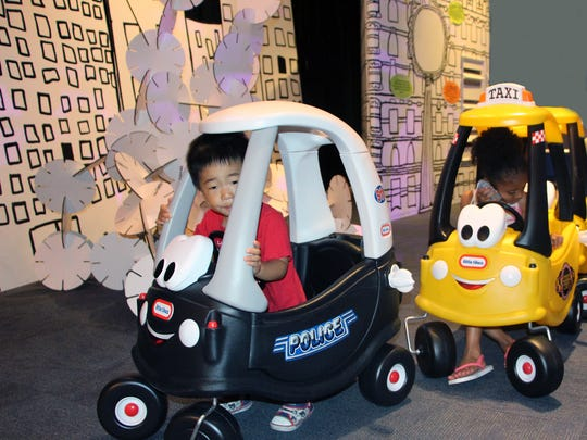 Kids can pretend to drive police cars and taxis in a new gallery at the Children's Museum of Manhattan.