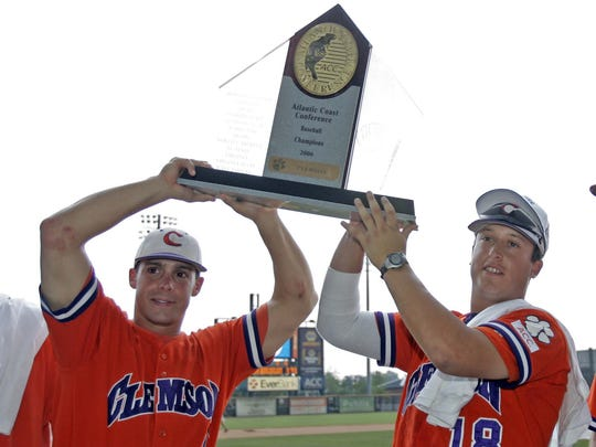 Clemson's Herman Demmink, left, and Jason Berken hold the Atlantic Coast Conference baseball championship trophy after their 8-4 win against North Carolina State in the ACC tournament in 2006.