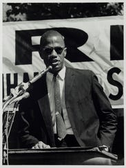"""Malcolm X Speaks at a Rally in Harlem (at 115th St."