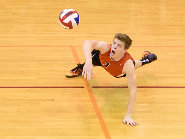 Central York's Kyle Male (3) lays out for a dig on
