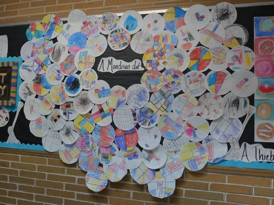Dot-inspired artwork by Winslow School students.