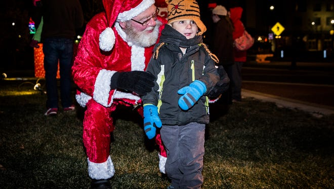 Light Up DWNTWN in 2017 featured live music, food, a tree lighting ceremony with Santa and Charlie Cardinal and the Holiday Makers Market tent at Canan Commons.