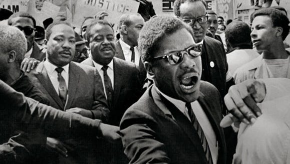 Martin Luther King Jr. and Ralph Abernathy led the march on behalf of striking Memphis sanitation workers March 28, 1968. When some broke windows, King stopped the march and vowed to have a nonviolent march on April 5. He didn't live to see that day.