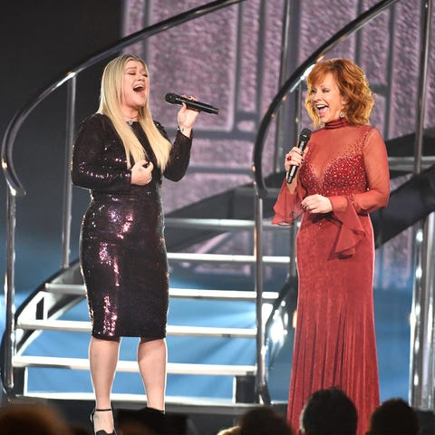 Kelly Clarkson, left, and host Reba McEntire...