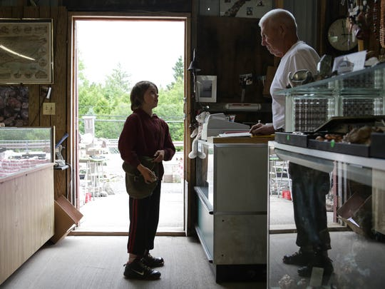 Luke Jarvi, 10, of Copper City brings in minerals to Prospector's Paradise in Allouez for owner Alex Fagotti, 74, to examine. In Copper Country, where years of mining have left minerals unearthed, rock collecting isn't a hobby. Rocks are a livelihood.