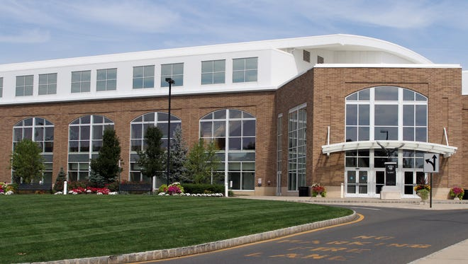 Monmouth University's Multipurpose Activity Center was renamed OceanFirst Bank Center on Tuesday as part of a 20-year, $4 million naming rights deal