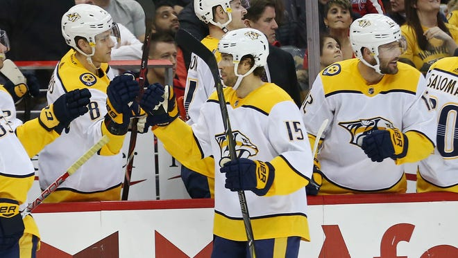 Apr 5, 2018; Washington, DC, USA; Nashville Predators right wing Craig Smith (15) celebrates with teammates after scoring a goal against the Washington Capitals in the first period at Capital One Arena.