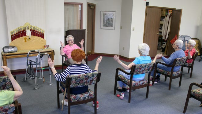In this April 29, 2014 photo, Hildegard Gigl, leads a twice weekly exercise class at Hawthorne Terrace independent retirement center in Wauwatosa, Wis. Gigl, who turns 99 in June, is the oldest one in the class. (AP Photo/Carrie Antlfinger)