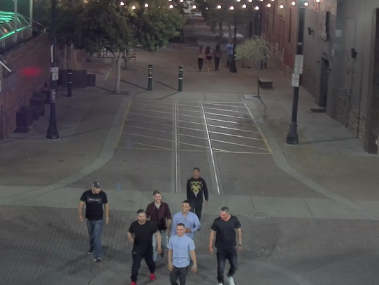 Detectives are trying to identify the men in this image