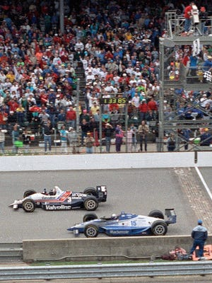 In this May 24, 1992, file photo, Al Unser Jr., top, of Albuquerque, N.M., wins the Indianapolis 500 by less than a car length ahead of Scott Goodyear, of Canada, at Indianapolis Motor Speedway in Indianapolis. In a survey of the 27 living winners of the Indy 500, The Associated Press found the 1992 race won by Al Unser Jr. to be the greatest in history. Other memorable races included Little Al's loss to Emerson Fittipaldi in '89, Sam Hornish Jr.'s victory in 2006 and the second win for the late Dan Wheldon in 2011.