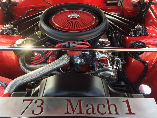 The tricked-out engine of a 1971 Mustang Mach 1 shines