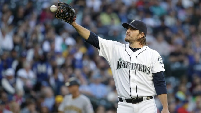 Seattle Mariners starting pitcher Wade Miley in action against the Pittsburgh Pirates in a baseball game Wednesday, June 29, 2016, in Seattle. (AP Photo/Elaine Thompson)
