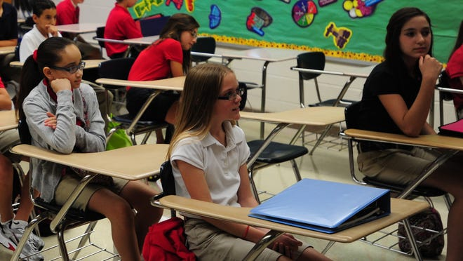 A federal judge has ordered Louisiana education officials to provide federal lawyers with regular reports each year on students and schools involved in a state voucher program that provides public funding for some students attending private schools.