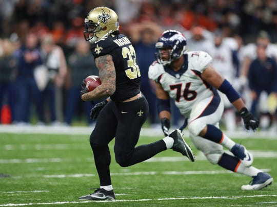 New Orleans Saints safety Kenny Vaccaro (32) returns an interception against the Denver Broncos in New Orleans, Sunday, Nov. 13, 2016.