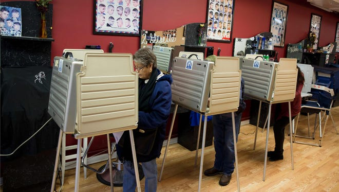 Voters head to the polls on at Delia's Beauty Salon and Barber Shop in Gage Park in Chicago on March 15, 2016.