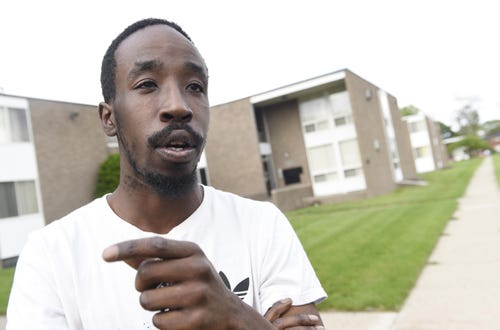 detroit-man-pulls-young-brothers-away-from-pit-bulls