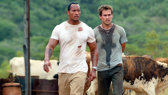 "Dwayne Johnson (left) and Seann William Scott are not exactly fast friends in ""The Rundown."""