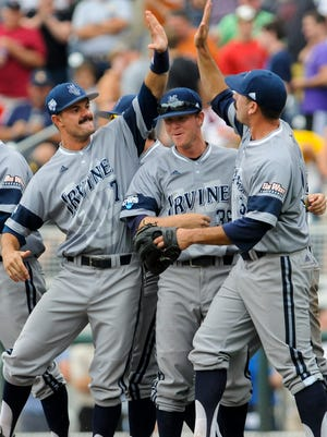 UC Irvine players Ryan Cooper (7) and Jonathan Herkins, center, celebrate with pitcher Evan Brock, right, following a 3-1 win over Texas on Saturday.