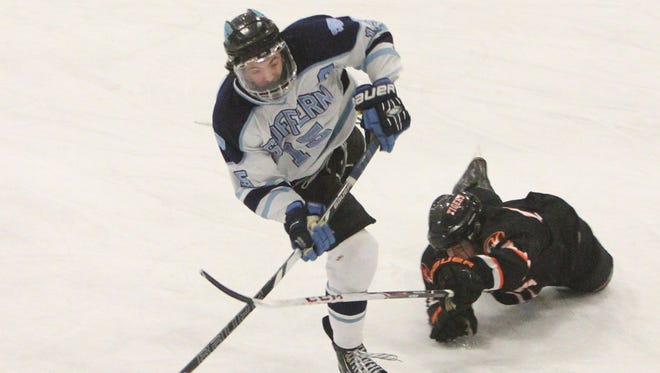 Suffern's Kevin Hill shoots under pressure from White Plains' Chris Medeot during their Section 1 Division 1 semifinal at Sport-O-Rama in Monsey Feb. 18, 2014. ( Peter Carr / The Journal News )