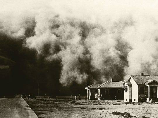 A huge dust storm moves across the land during the