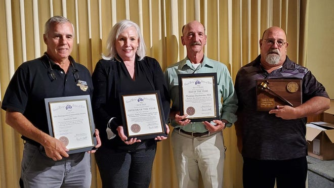 Left to right: Dennis Dube, Citizen of the Year; Bonnie Skidds, Officer of the Year; Tom Ducharme, Elk of the Year and Jim Clark, GER Award Recipient.