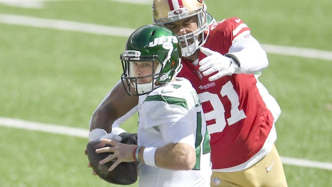 San Francisco 49ers defensive end Arik Armstead (91) sacks New York Jets quarterback Sam Darnold during the first half of Sunday's game in East Rutherford, New Jersey.