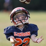 Justice Mabry, 6, catches a ball as he warms up with the other members of the Lyndon Lightning Mighty Mites before they scrimmaged at A.B. Sawyer Park.  The park covers 47 acres.  The Lyndon Lightning Football Team falls under Lyndon Recreation which has been around for 35 years.  Lyndon Recreation has 2500 participants in the baseball, softball and football programs for ages 5-13. September 1, 2015