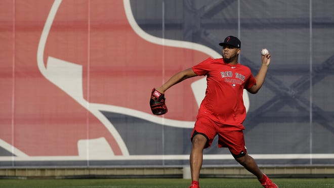 Boston Red Sox relief pitcher Darwinzon Hernandez throws after reporting for spring training baseball on Feb. 11, 2020, in Fort Myers, Fla. Hernandez isn't at Summer Camp due to testing positive for the coronavirus.