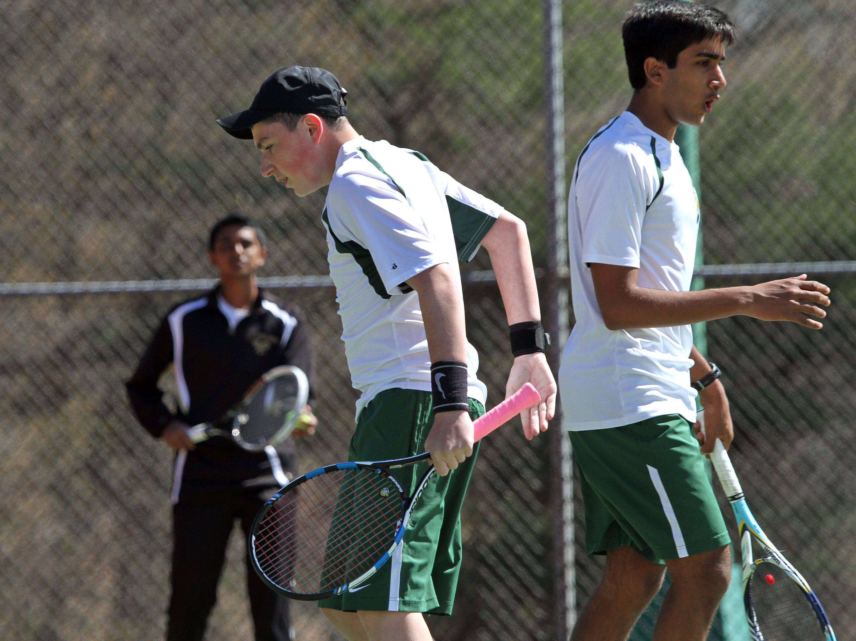 J.P.Stevens' First Doubles team Alex Telson, left, and Gouttham Chandrasekar celeebrate a point during their match at the GMC tennis tournament finals at Thomas Edison Park in Edison.