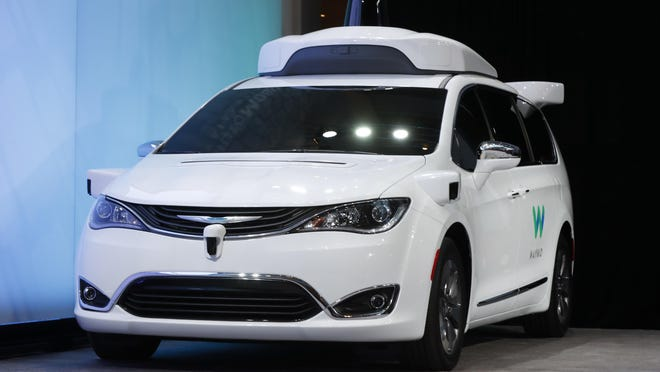 A Chrysler Pacifica hybrid outfitted with Waymo's suite of sensors and radar is shown at the North American International Auto Show in Detroit.