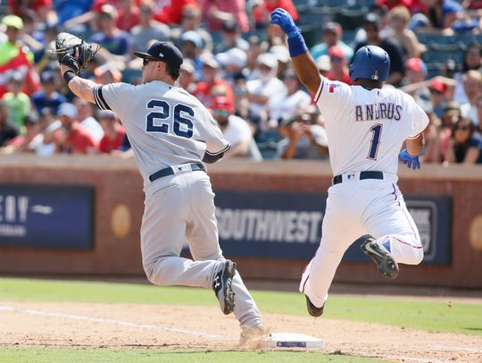 Texas Rangers shortstop Elvis Andrus (1) is out at