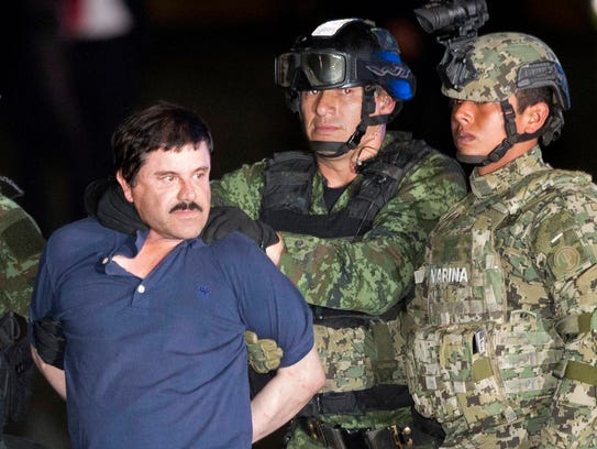 "Joaquin ""El Chapo"" Guzman faces the press as he is"