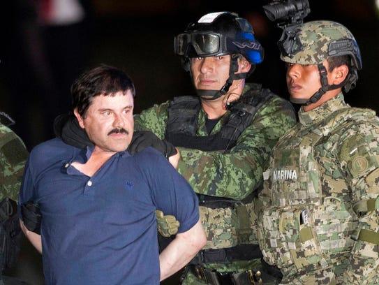"""Joaquin """"El Chapo"""" Guzman faces the press as he is"""