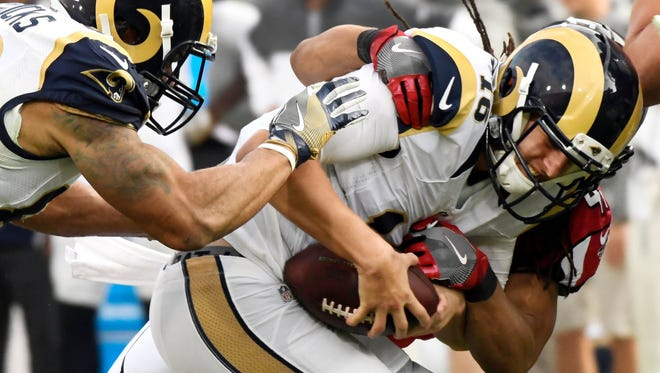 Rams quarterback Jared Goff is sacked by the Falcons'  Philip Wheeler during Sunday's loss. It was the last game with Jeff Fisher as L.A.'s head coach.