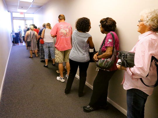 Voter stand in a long line to vote on the first day of early voting in Murfreesboro, on Oct. 19, 2016. At least 40 people were in line when the polls opened this morning.