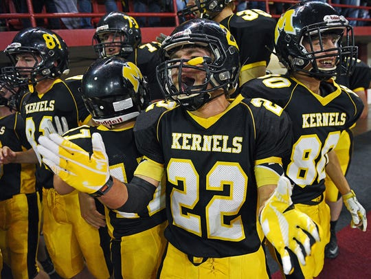 Mitchell's Drew Kitchens (22) reacts after a teammate