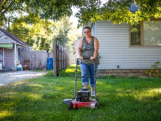 """I bought a mower today,"" said Laura Warrick, as she prepared to mow the yard of her new home on Wednesday, August 9, 2017. ""Eventually, this will be Jamie's job. He wants a dog so he'll have to have some chores."""