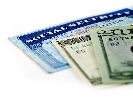 Social security identification and twenty dollar bills
