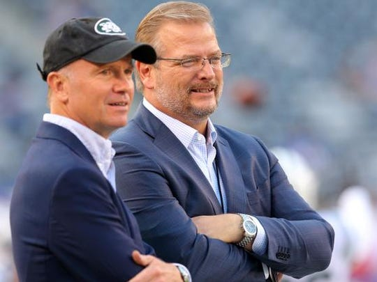 Jets acting owner Christopher Johnson, left, and general manager Mike Maccagnan.
