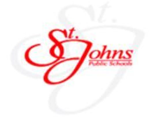 A St. Johns schools employee has been placed on leave while police investigate a complaint about a matter dating back nearly 20 years.