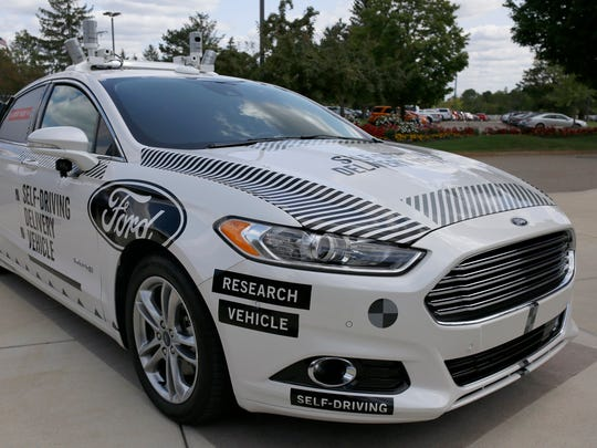 The Ford Fusion hybrid autonomous research vehicle, which will be used as the self-driving pizza delivery vehicle.