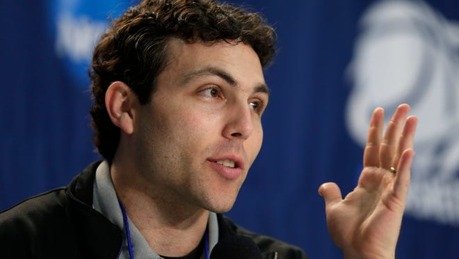 FILE - In this March 22, 2014, file photo, Memphis head coach Josh Pastner answers a question during a news conference at an NCAA college basketball tournament in Raleigh, N.C. After a season leaning on a quartet of senior guards, the Memphis Tigers are moving inside with leadership and experience on the frontline as they head into their second season in the American Athletic Conference. (AP Photo/Chuck Burton, File)