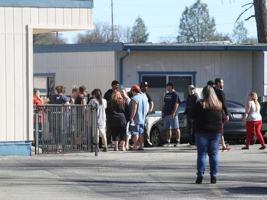 Parents wait to pick up their kids Wednesday at Buckeye