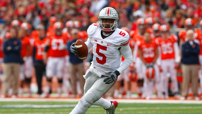 Ohio State quarterback Braxton Miller (5) runs against Illinois during an NCAA college football game in Champaign, Ill. Miller is shifting from quarterback to receiver, whittling Ohio State's QB competition to two star passers. Miller told SI.com on Thursday night, July 23, that he plans to start the season in the H-back position and also hopes to return punts. He had surgery to repair of torn labrum in his throwing shoulder before the start of last season.