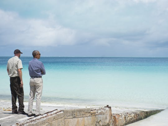 President Barack Obama and Marine National Monuments Superintendent Matt Brown tour Midway Atoll in the Papahanaumokuakea Marine National Monument in the Pacific Ocean.