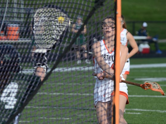 Northville's Charlotte Beaudoin (right) had this shot