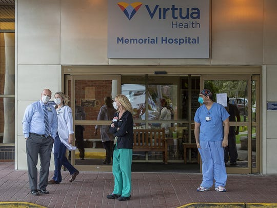File - Virtua Memorial Hospital Mount Holly healthcare workers start to come outside to view the solidarity parade in their honor, Wednesday, April 8, 2020.