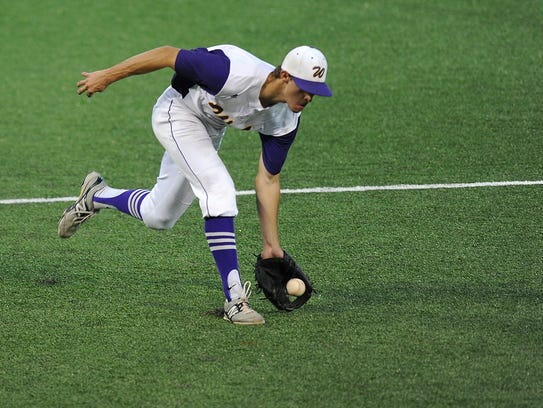 Wylie third baseman Tyler Henson (43) fields a ball