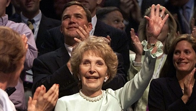 Nancy Reagan waves to the delegates at the Republican National Convention in 2000.